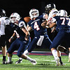 Isaiah DuncanI, of Independence, third from left, throws a pass downfield during game against Liberty at Independence High School Friday, October 2.<br /> (Rick Barbero/The Register-Herald)