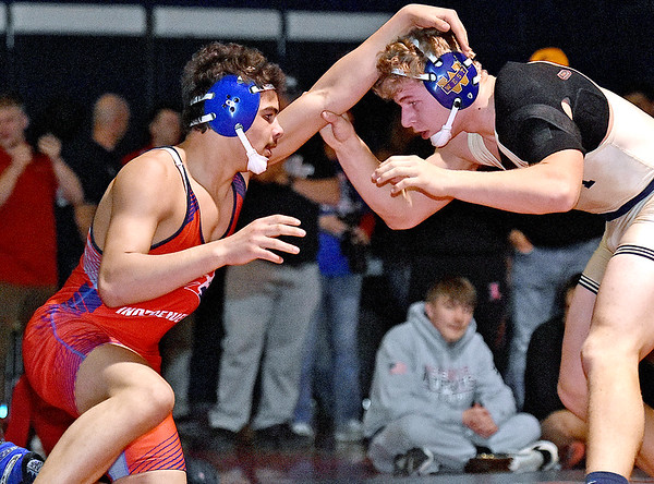 (Brad Davis/The Register-Herald) Independence's Sam Adams takes on Greenbrier West's John Parks for the Class AA, Region 3, 170-pound weight class championship Saturday night in Coal City. Indy's Adams won the match.