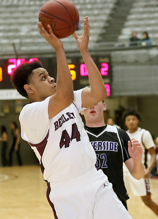 (Brad Davis/The Register-Herald) Woodrow Wilson's Jevon Ely drives to the basket as Riverside's Alec Hess defends Wednesday night at the Beckley-Raleigh County Convention Center.