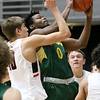 (Brad Davis/The Register-Herald) Greenbrier East's Quentin Wilson drives to the basket as University's Blake Barkley defends during Big Atlantic Classic action Friday at the Beckley-Raleigh County Convention Center.