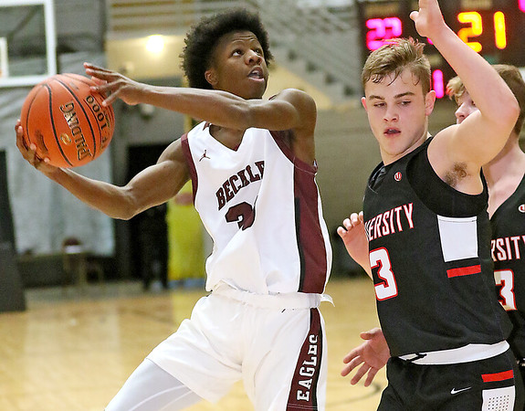 (Brad Davis/The Register-Herald) Woodrow Wilson's Dwayne Richardson drives to the basket as University's Kaden Metheny defends during the final night of Big Atlantic Classic action Saturday at the Beckley-Raleigh County Convention Center.
