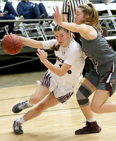 (Brad Davis/The Register-Herald) Woodrow Wilson's Liz Cadle drives to the basket as George Washington's Mary Lyle Smith defends during the final night of Big Atlantic Classic action Saturday at the Beckley-Raleigh County Convention Center.