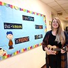 Brittany McGuire, music teacher, singing in the empty hallway at Crescent Elementary School. She videos her songs and post them for her students on Crescent Elementary's Facebook page. .<br /> (Rick Barbero/The Register-Herald)