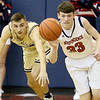 (Brad Davis/The Register-Herald) Independence's Zach Bolen beats Greenbrier West's Chase Hagy to a loose rebound Thursday night in Coal City.