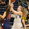 (Brad Davis/The Register-Herald) Shady Spring's Kacey Poe puts up a short-range shot off a drive as Independence's Bella Acord defends Thursday night in Shady Spring.