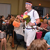 """(Brad Davis/The Register-Herald) Cody Reedy mingles among the crowd seeking dollars during the Hunks in Heels """"Fur"""" Real fundraising event Friday night at the Beckley Moose Lodge."""