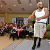 """(Brad Davis/The Register-Herald) Justin Thompson struts for the crowd during the Hunks in Heels """"Fur"""" Real fundraising event Friday night at the Beckley Moose Lodge."""