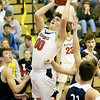 (Brad Davis/The Register-Herald) Independence's A.J. Zilinski drives to the basket as Shady Spring's Grey Hazuka defends Friday night in Coal City.