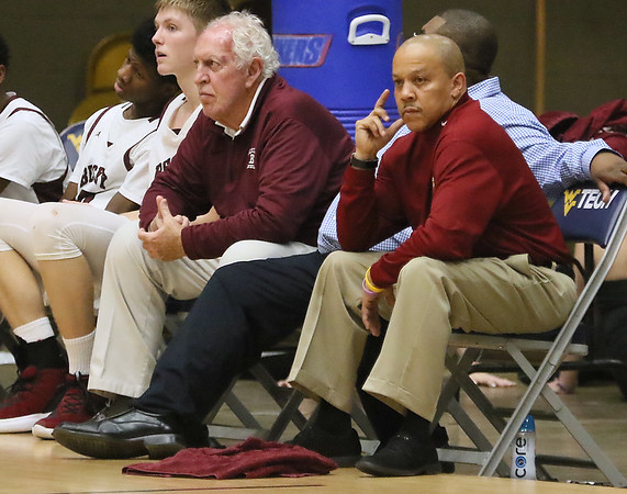 (Brad Davis/The Register-Herald) Woodrow head coach Ron Kidd and assisant Dave Barksdale watch from the bench during a blowout win against Riverside Wednesday night at the Beckley-Raleigh County Convention Center.