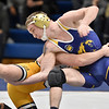 (Brad Davis/The Register-Herald) WVU Tech's Devin Wilhelm takes on Reinhardt's Curtis Doctor in a 149-pound weight class matchup Friday night inside Tech's Vam Meter Gym. Reinhardt's Doctor won the match.