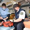 Deborah Given, left, driver, and Amanda Ellison, EMT, checking equipment in a JanCare Ambulance.<br /> (Rick Barbero/The Register-Herald)