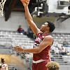Bluefield's Sean Martin goes up for a layup during the first half of their Big Atlantic Classic basketball game against James Monreo in Beckley on Monday. (Chris Jackson/The Register-Herald)