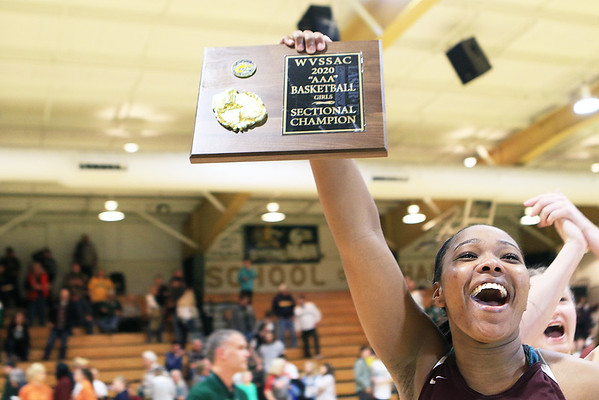 Woodrow Wilson's Victoria Staunton celebrates after winning the Class AAA Region 3 Section 2 championship game at Greenbrier East in Fairlea Friday. (Jenny Harnish/The Register-Herald)