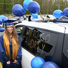 Audrey Flanagan waits in the parking lot at Shady Spring High School to receive her diploma. Due to the COVID-19 global pandemic, students at Shady Spring High School were not able to take part in the traditional graduation ceremony like students in the past, but their administration made accommodations so their parents and family members could watch them walk across the stage, receive their diplomas, and turn their tassels Friday evening in front of the school.<br /> (Rick Barbero/The Register-Herald)