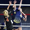 Sullivan Pivont, of Summers Co., left, tries to block, Meagan Poticher hit, of Greenbrier West, during the quarter-final match of the Girls State Volleyball Tournament held at the Charleston Civic Center Wednesday morning.<br /> (Rick Barbero/The Register-Herald)