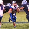 Meadow Bridge defenders, Caidan Connor and Ty Roles attempt to bring down Midland Trail's Christopher Vines. Chad Foreman for the Register-Herald.