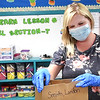 Katie Cooper, third grade teacher at Crescent Elementary School, bags up materials belonging to her students for them to pick up at a later date. Students normally help, but could not because of COVID-19.<br /> (Rick Barbero/The Register-Herald)