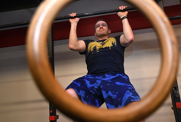 Caleb Workman, of Beaver, works out at Redline Fitness in Beckley. Redline was closed down due to COVID-19 and reopened on Monday, May 18.<br /> (Rick Barbero/The Register-Herald)
