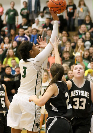 (Brad Davis/The Register-Herald) Wyoming East's Daisha Summers drives to the basket as Westside's Leslie Bailey defends Wednesday night in New Richmond.