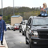 Katie Bolen, right, photographs her brother Jaysen Bolen walking to get his diploma at Shady Spring High School. Due to the COVID-19 global pandemic, students at Shady Spring High School were not able to take part in the traditional graduation ceremony like students in the past, but their administration made accommodations so their parents and family members could watch them walk across the stage, receive their diplomas, and turn their tassels Friday evening in front of the school.<br /> (Rick Barbero/The Register-Herald)