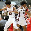 (Brad Davis/The Register-Herald) Woodrow Wilson's Bryant Jones, right, reacts with teammate Keynan Jones after hitting a half-court shot as time expired in the first quarter Friday night at the Beckley-Raleigh County Convention Center.