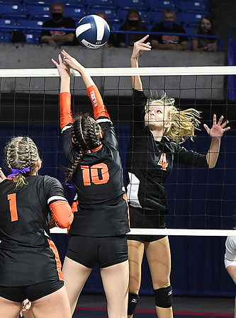 Sullivan Pivot, of Summers Co., right, smacks the ball over the net against Wirt Co., during the semi-final match of the Girls State Volleyball Tournament held at the Charleston Civic Center Wednesday morning. Summers Co. lost 3 sets to 1<br /> (Rick Barbero/The Register-Herald)