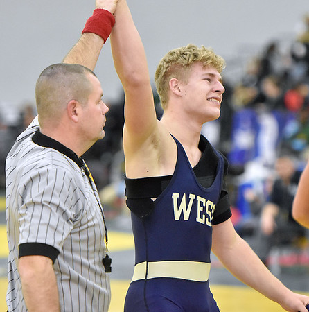 (Brad Davis/The Register-Herald) Greenbrier West's John Parks begins to shed a few tears of joy as he's declared the winner after defeating Fairmont Senior's Nick Scott to advance to the 170-pound final Friday night at the 73rd Annual State Wrestling Tournament in Huntington.