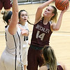 (Brad Davis/The Register-Herald) Woodrow Wilson's Olivia Zolkowski drives to the basket as PikeView's Shiloh Bailey defends during the New River Community and Technical College Shootout Saturday at the Beckley-Raleigh County Convention Center.