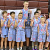 (Brad Davis/The Register-Herald) The Court Kings pose for photos with the trophy after defeating WV Villians for the Roundball Classic 5th Grade Championship Sunday morning at Woodrow Wilson High School.