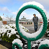 Trinity Bennett, of Hico, walks through the parking lot near Word Park on Neville Street in Beckley with about an Inch of snow around him that dropped Wednesday morning. <br /> (Rick Barbero/The Register-Herald)
