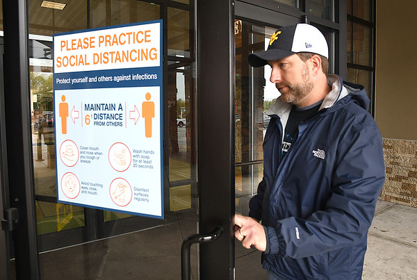 David Romaze, of Daniels, enters the Crossroads Mall Thursday morning. The Mall opened 11 am Thursday for the first time in two monthes because of COVID-19. <br /> (Rick Barbero/The Register-Herald)