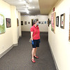 Elizabeth Harralson, of Lexington, Va., looks over the Youth Art Gallery at Tamarack. The Youth Art Gallery is open to the public and the display will be up until September 14. <br /> Rick Barbero/The Register-Herald)