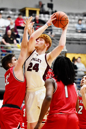 Woodrow Wilson's Ben Gilliam (24) goes up for a shot over St. Albans Braxton Good (32) during the fourth quarter of their Class AAA, Region 3 Conference Final Game against St. Albans in Beckley on Tuesday. (Chris Jackson/The Register-Herald)
