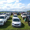 Vehicles line the West Virginia State Fairgrounds parking lot on Saturday during the Greenbrier East High School graduation ceremonies. Parents drove their graduates to a stage and students walked individually across the stage and were handed their diplomas.<br /> (Christian Giggenbach/for The Register-Herald)