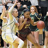 Woodrow Wilson's Victoria Staunton tries to get past Greenbrier East's Haley McClure during the Class AAA Region 3 Section 2 championship game at Greenbrier East in Fairlea Friday, February 28. (Jenny Harnish/The Register-Herald)