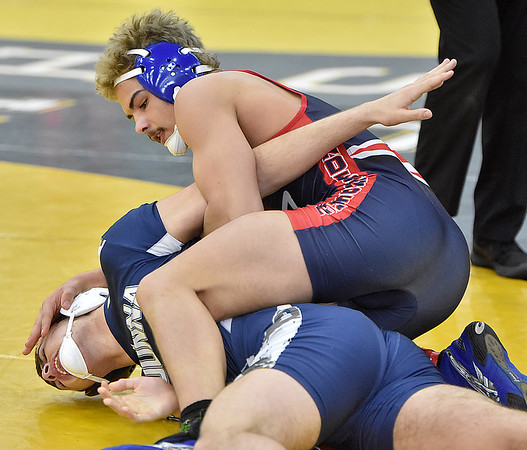 (Brad Davis/The Register-Herald) Independence's Sam Adams takes on Madonna's Evan Daniels in a 170-pound weight class matchup Friday afternoon at the 73rd Annual State Wrestling Tournament in Huntington. Indy's Adams won the match.