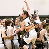 (Brad Davis/The Register-Herald) Westside's Makayla Morgan, middle, is lifted into the air by fellow students rushing the court to celebrate with their Renegade classmates after defeating Bluefield in the Region 3 co-final to earn a berth in next week's state tournament Thursday night in Clear Fork.