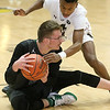 (Brad Davis/The Register-Herald) Wyoming East's Anthony Martin looks for an open teammate after scrumming for a loose ball with Bluefield's Tyree Hairston during the final day of Big Atlantic Classic action Saturday at the Beckley-Raleigh County Convention Center.