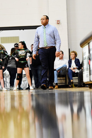 Wyoming East's Head Coach Derek Brooks watches his side during the first half of their basketball game in Clear Fork on Tuesday. (Chris Jackson/The Register-Herald)