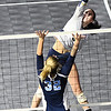 Chloe Thompson, of Shady Spring, taps the ball over the net against Phillips Barbour in the Class AA championship match of the girls volleyball tournament in Charleston Friday even held at the Charleston Civic Center. Shady won the Championship 3-0<br /> (Rick Barbero/The Register-Herald)