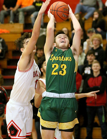 (Brad Davis/The Register-Herald) Greenbrier East's Sam Aultz drives to the basket as Oak Hill's Jacob Perdue defends Wednesday night in Oak Hill.