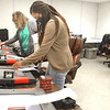 Stephanie Ellison and Tammy Richardson assist Cecilia Chapman, at right, in tabulating results from tests conducted on voting machines in Beckley, on Wednesday, May 20. Jon C. Hancock/Register-Herald