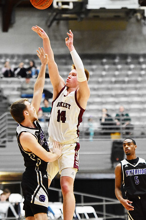 Woodrow Wilson's Maddox McMillen puts up a shot over Riverside's (23) during their Class AAA Region 3, Section 2 tournament game in Beckley on Wednesday. (Chris Jackson/The Register-Herald)