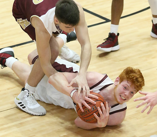 (Brad Davis/The Register-Herald) Woodrow Wilson's Ben Gilliam scrums for a loose ball with George Washington's Jack Ingold Friday night at the Beckley-Raleigh County Convention Center.