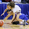 (Brad Davis/The Register-Herald) Woodrow Wilson's Keanti Thompson comes up with another loose ball off a strong defensive play to take it away from Morgantown's Alayjah Jones during Girls State Basketball Tournament Wednesday afternoon in Charleston.