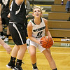 (Brad Davis/The Register-Herald) Wyoming East's Skylar Davidson drives to the basket as Westside's Lauren Thomas defends Wednesday night in New Richmond.