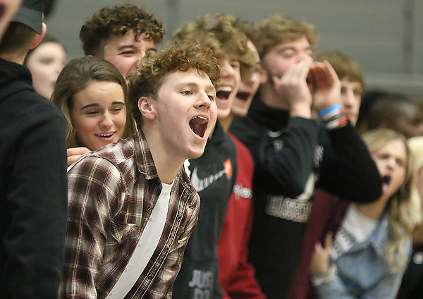 (Brad Davis/The Register-Herald) Woodrow students try to distract a Princeton free throw shooter Friday night.
