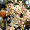 (Brad Davis/The Register-Herald) Greenbrier West's Lawson Vaughan drives along the baseline as Independence's Jarred Cannady defends Thursday night in Coal City.