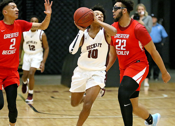 (Brad Davis/The Register-Herald) Woodrow Wilson's Bryant Jones fires a shot from mid court and makes it as time expires in the first quarter Friday night at the Beckley-Raleigh County Convention Center.