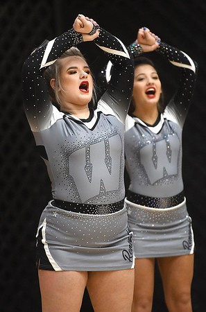Westside cheerleaders cheering for their team against Woodrow Wilson, during the second annual New River CTC Invitational held at the Beckley Raleigh County Convention Center. Woodrow won 60-35.<br /> (Rick Barbero/The Register-Herald)